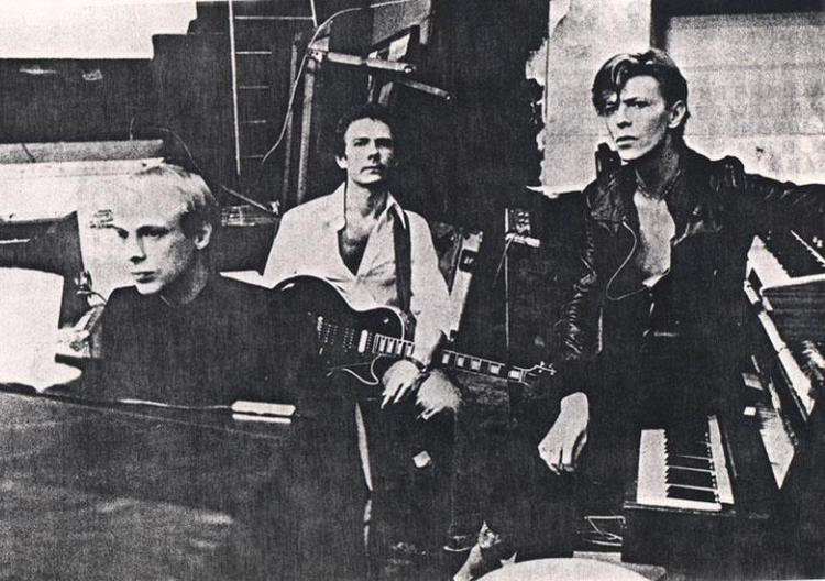 "Brian-Eno-Robert-Fripp-and-David-Bowie-Recording-""Heroes""-in-Berlin-1977.jpg"