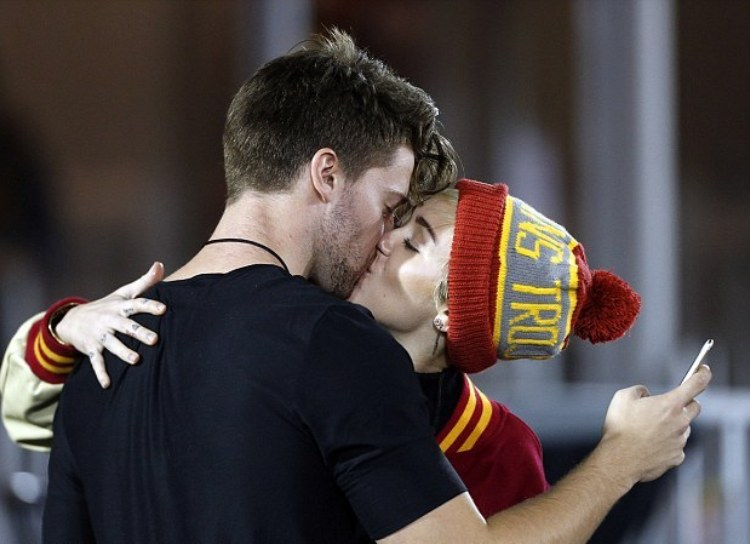 1415950419711_Image_galleryImage_Miley_Cyrus_and_Patrick_S.jpg